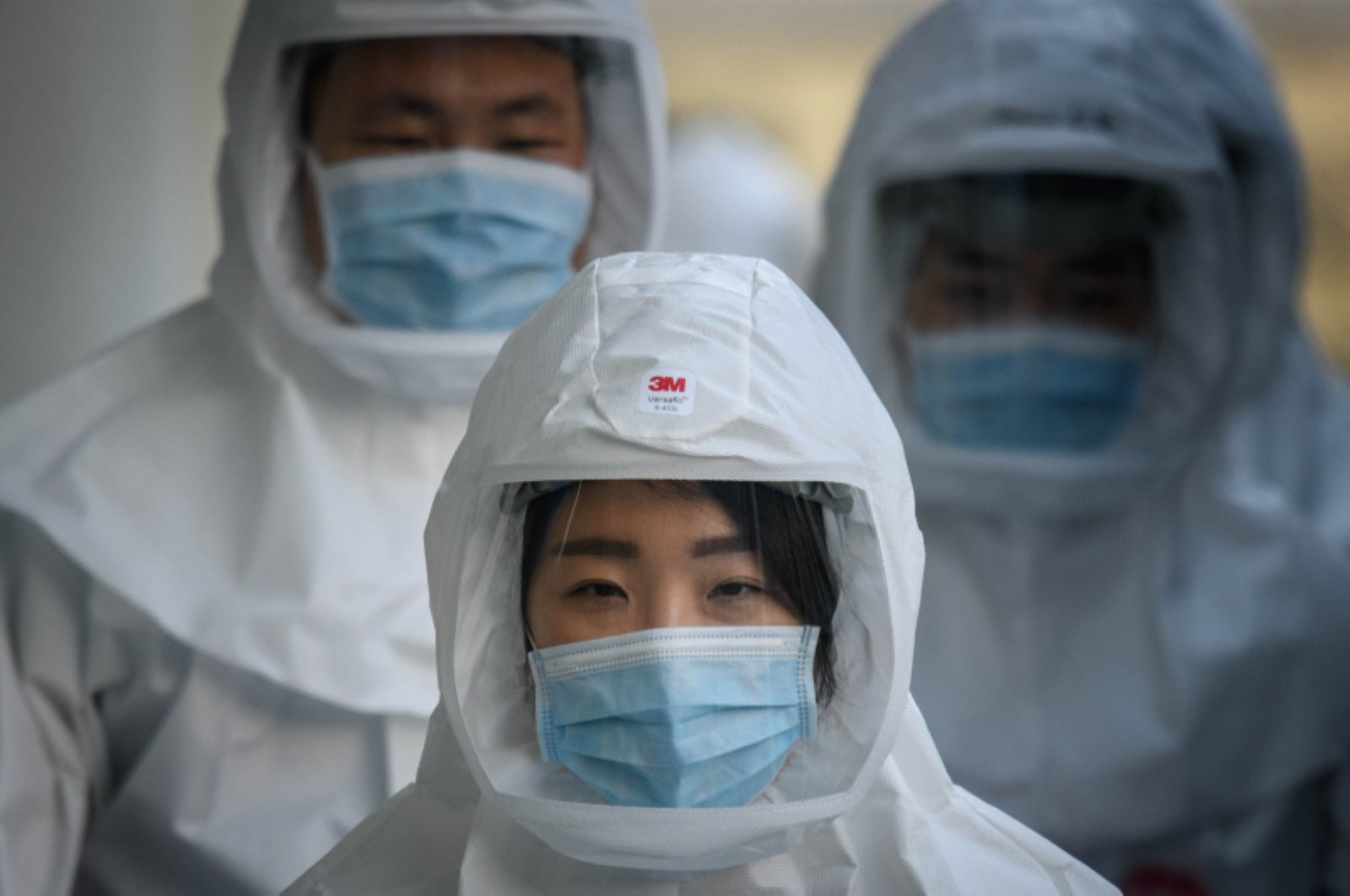 Medical workers wearing protective clothing against the novel coronavirus walk to a decontamination area at the Keimyung University Dongsan Hospital in Daegu, South Korea, March 12, 2020. (AFP Photo)