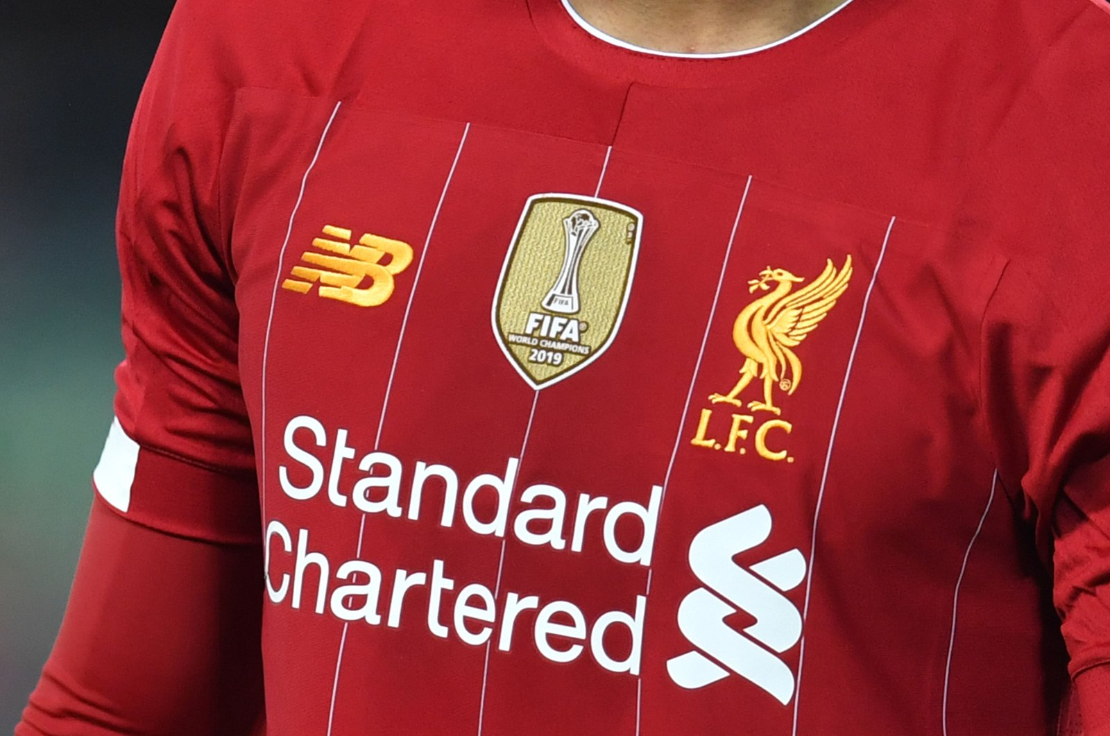 The emblem commemorating Liverpool's FIFA Club World Cup victory is seen on the shirt of defender Joe Gomez, during a Premier League football match, Liverpool, Dec. 29, 2019. (AFP Photo)