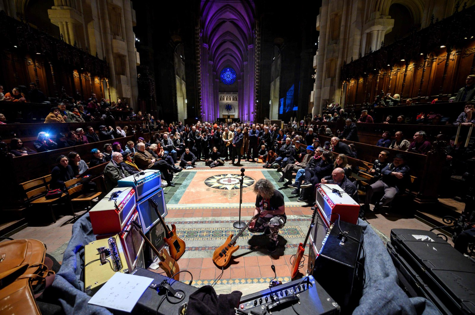 "In this file photo taken on March 13, 2019, late U.S. musician Lou Reed's former guitar technician Stewart Hurwood performs in the Cathedral Church of Saint Johan the Divine during the concert ""Lou Reed Drone"". The Cathedral Church of St. John the Divine in Manhattan will house nine climate-controlled medical tents in its 600-foot-long nave and subterranean crypt, dean Clifton Daniel told The New York Times. (AFP Photo)"