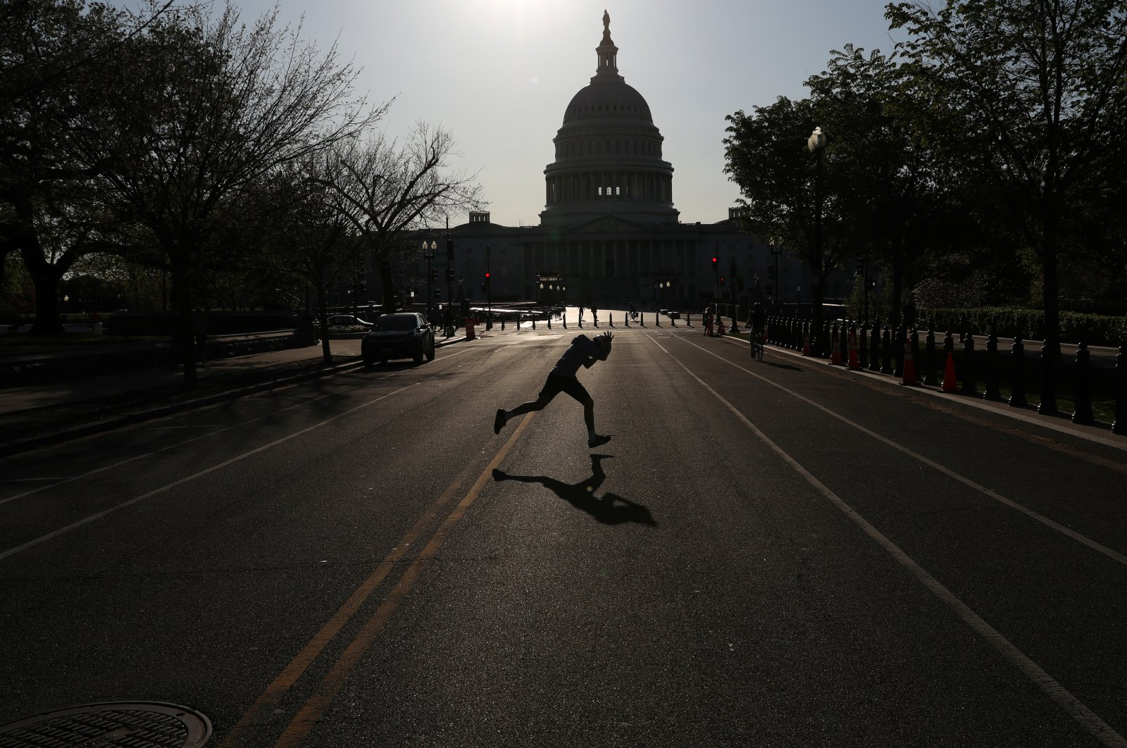 A child runs across East Capitol Street, a normally busy street outside of the U.S. Capitol building as the spread of the coronavirus continues in Washington D.C., U.S., Monday, April 6, 2020. (Reuters Photo)