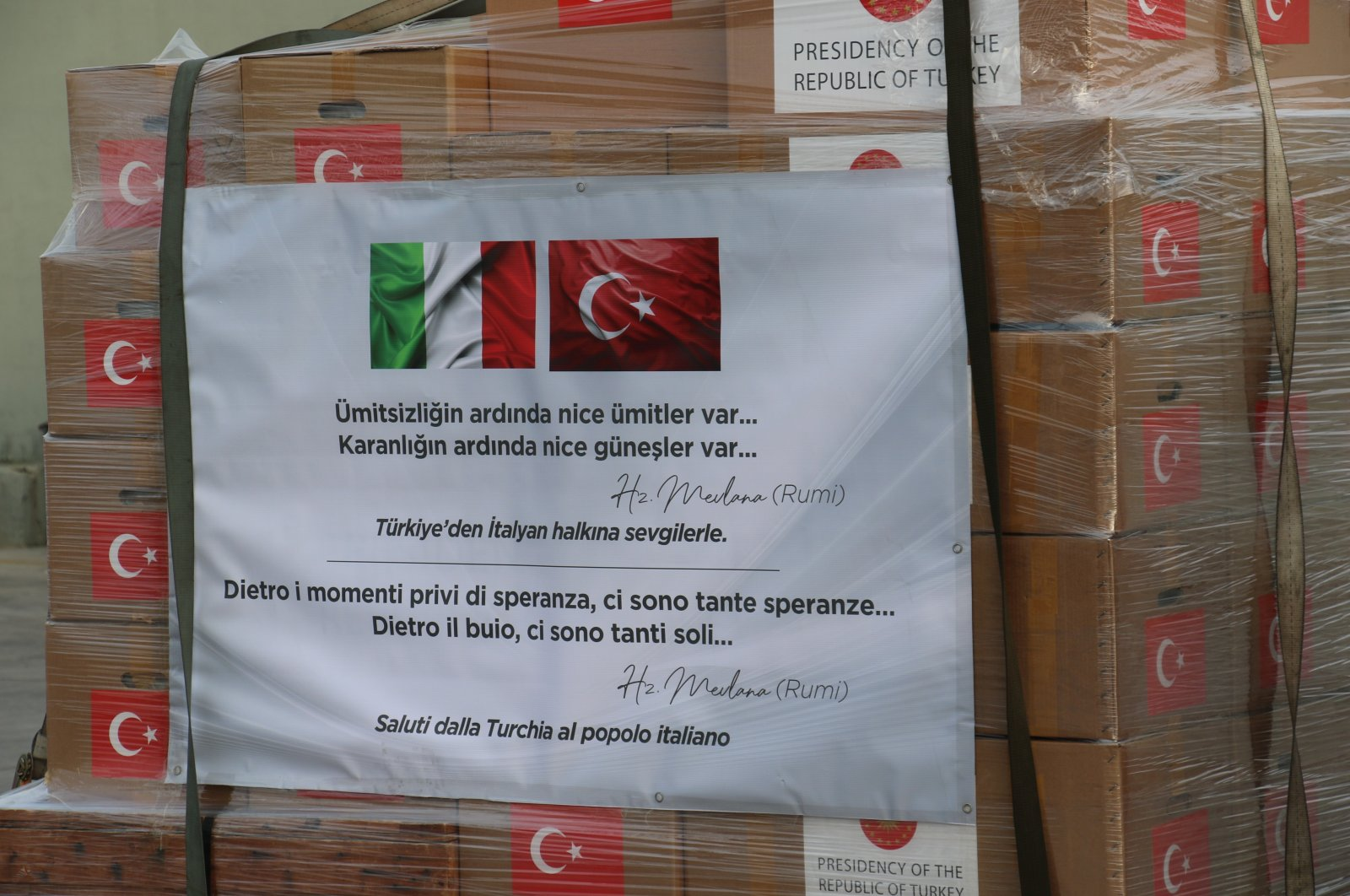"""""""There is hope after despair and many suns after darkness,"""" a quote by the 13th-century Sufi mystic Mevlana Jalaluddin Rumi, is seen on a coronavirus aid package prepared by Turkish authorities to be delivered to Italy to help combat the pandemic, Ankara, Turkey, Wednesday, April 1, 2020. (İHA Photo)"""