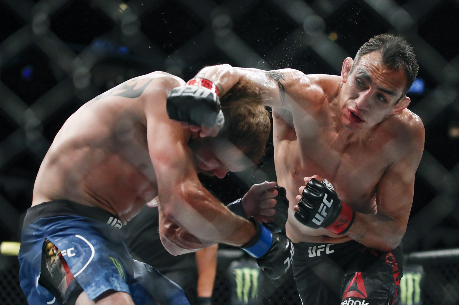Tony Ferguson (R) punches Donald Cerrone during their lightweight mixed martial arts bout at UFC 238 in Chicago, Illinois., U.S., June 8, 2019. (AP Photo)