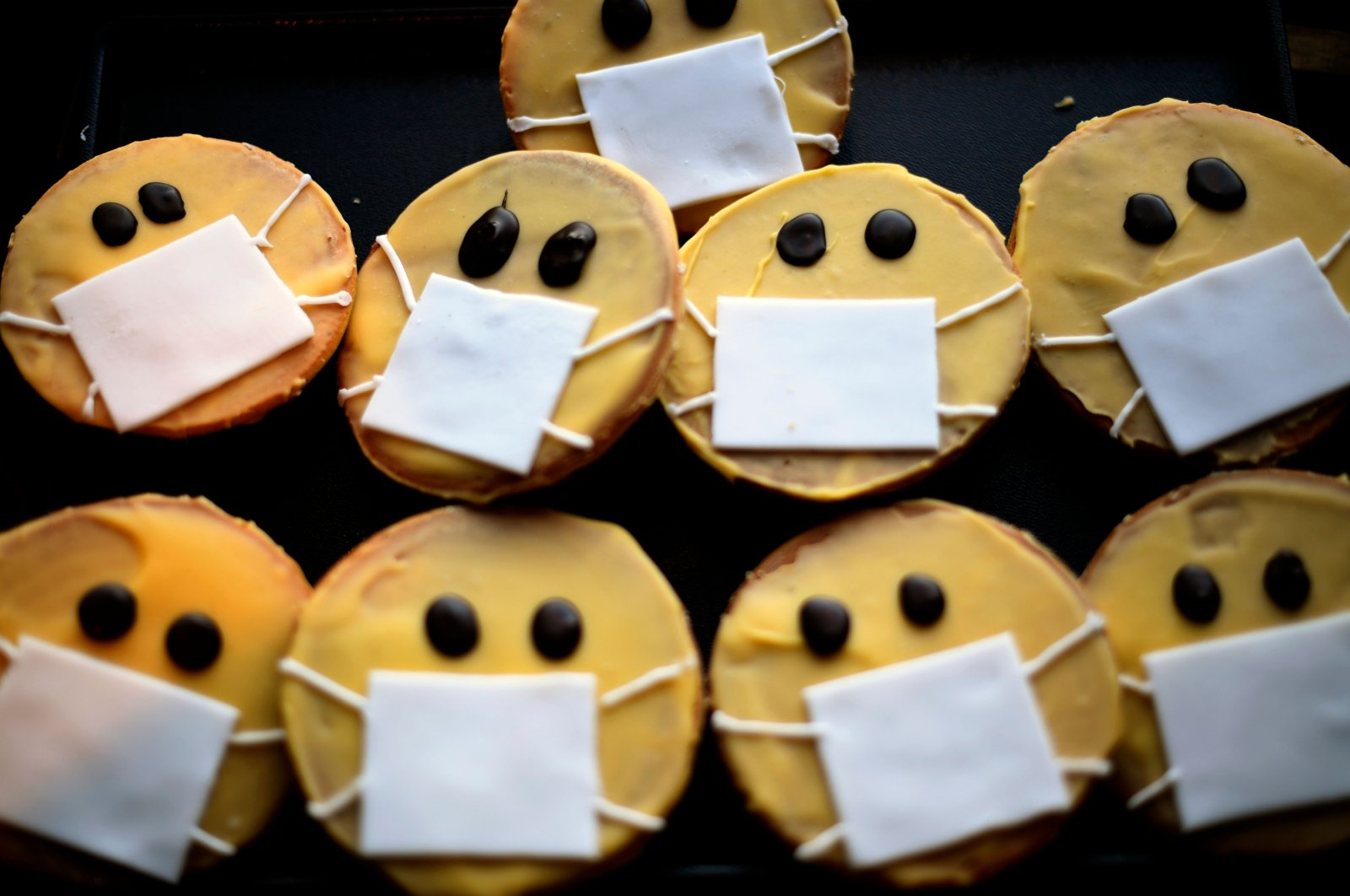 Biscuits featuring a face with a face mask are displayed at the bakery Schuerener Backparadies in Dortmund, German, Thursday, March 26, 2020. (AFP Photo)