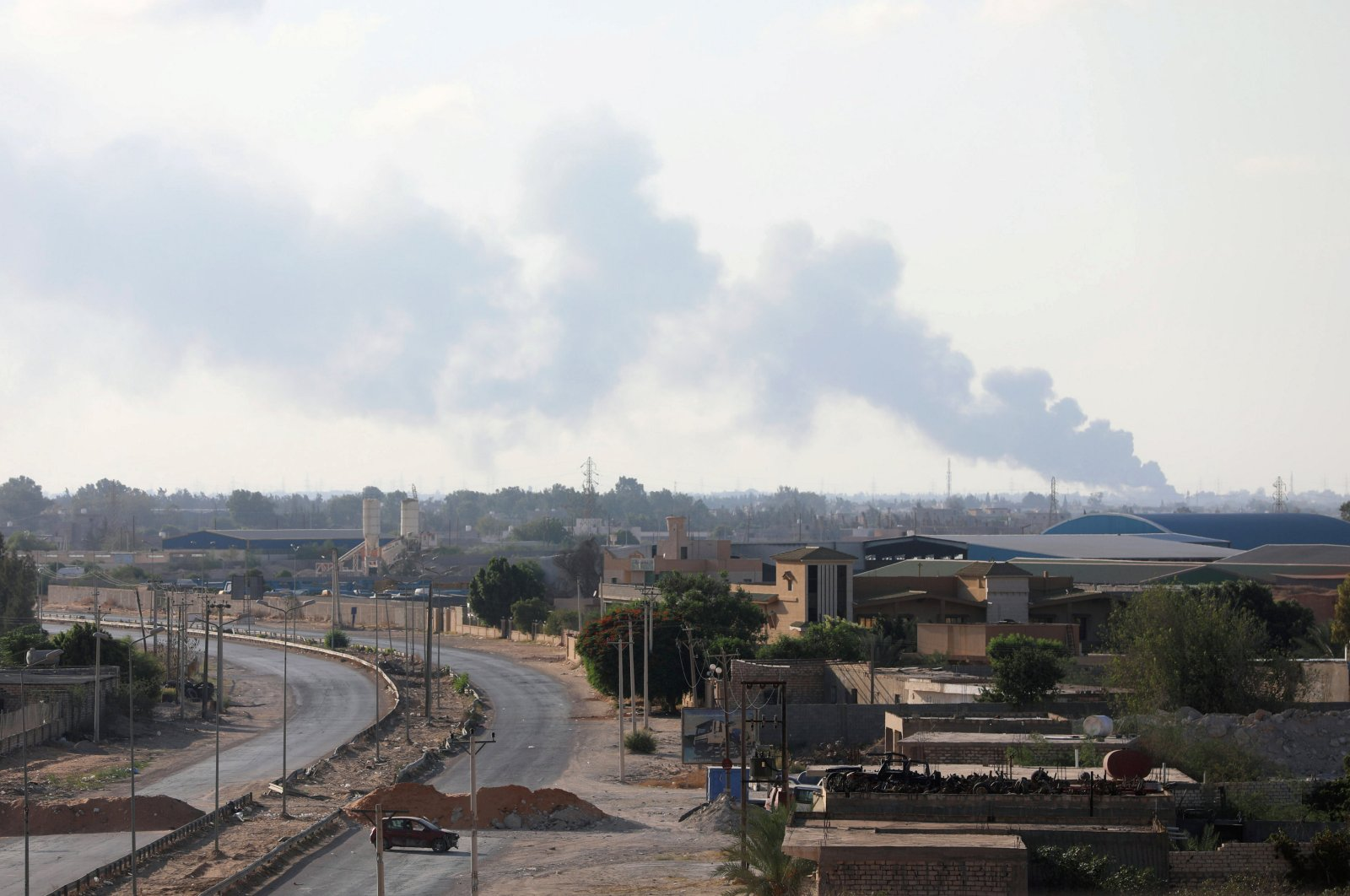 Smoke rises during clashes between forces allied to the internationally recognized government and armed groups in Tripoli, Libya, Sept. 22, 2018. (REUTERS Photo)