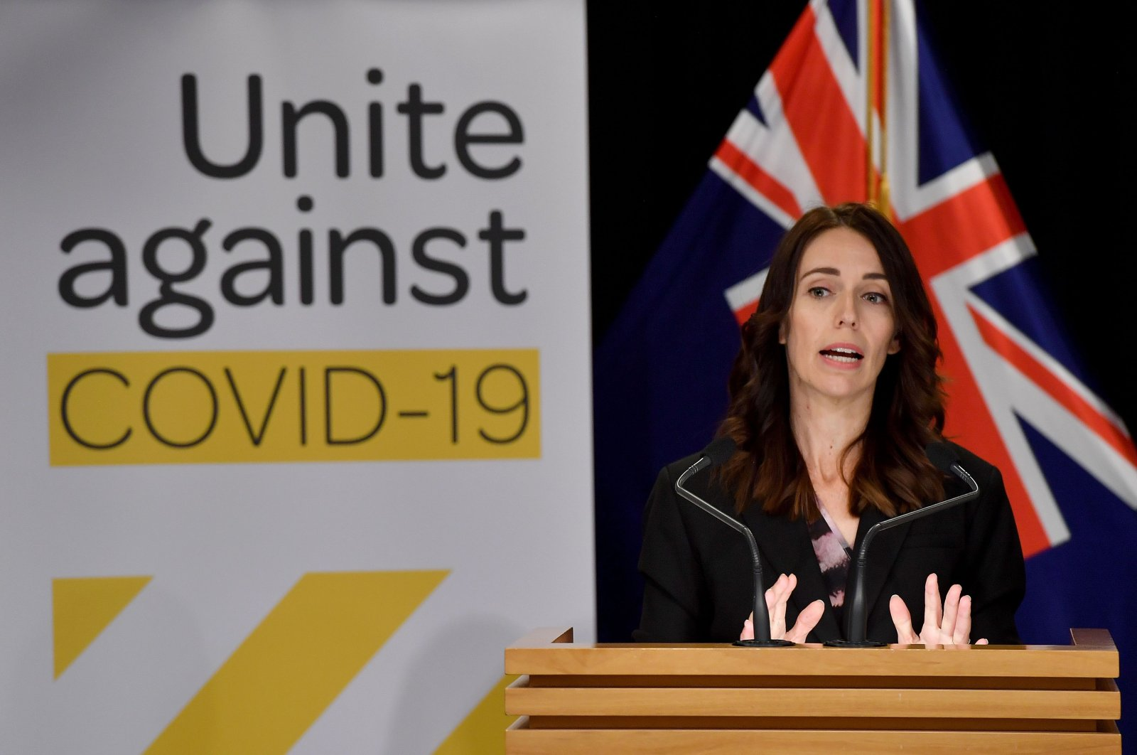 This file photo shows New Zealand's Prime Minister Jacinda Ardern speaking to the media during a press conference one day before the country went on lockdown to stop the progression of the coronavirus, at Parliament in Wellington, March 24, 2020. (AFP Photo)