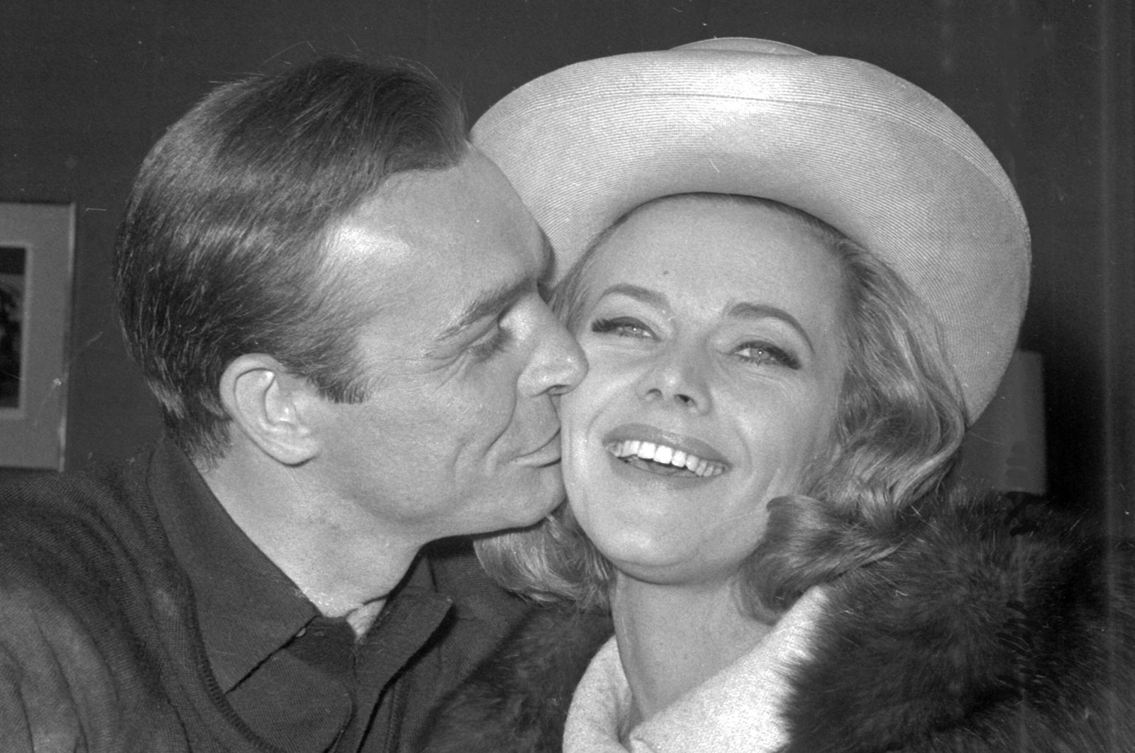 British actor Sean Connery kisses actress Honor Blackman during a party at Pinewood Film Studios, March 25, 1964, Iver Heath, England. (AP Photo)
