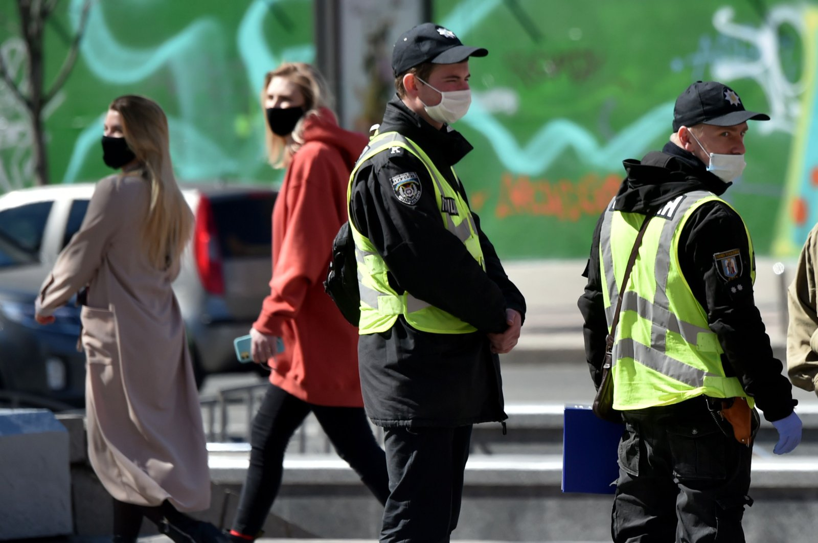 Police officers wearing face masks patrol the streets of Ukrainian capital Kyiv during a lockdown to prevent the spread of COVID-19, Monday, April 6, 2020. (AFP Photo)