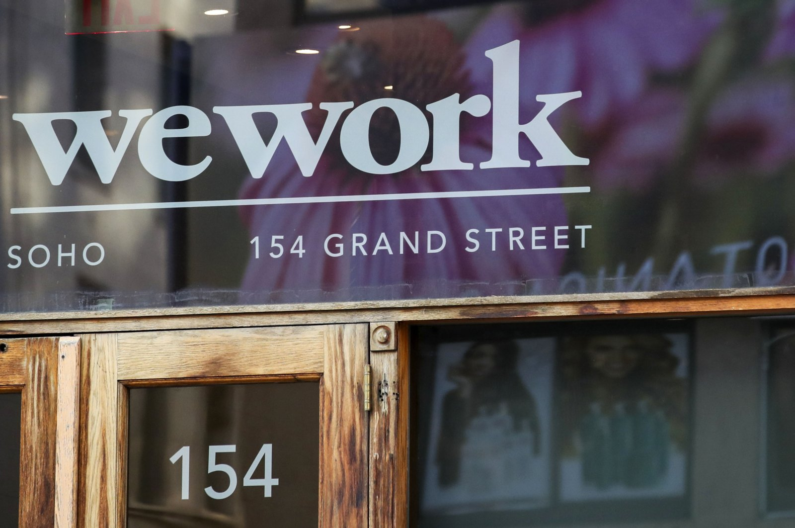 This Oct. 15, 2019, file photo shows a WeWork logo at the entrance to one of their office spaces in the SoHo neighborhood of New York. (AP Photo)