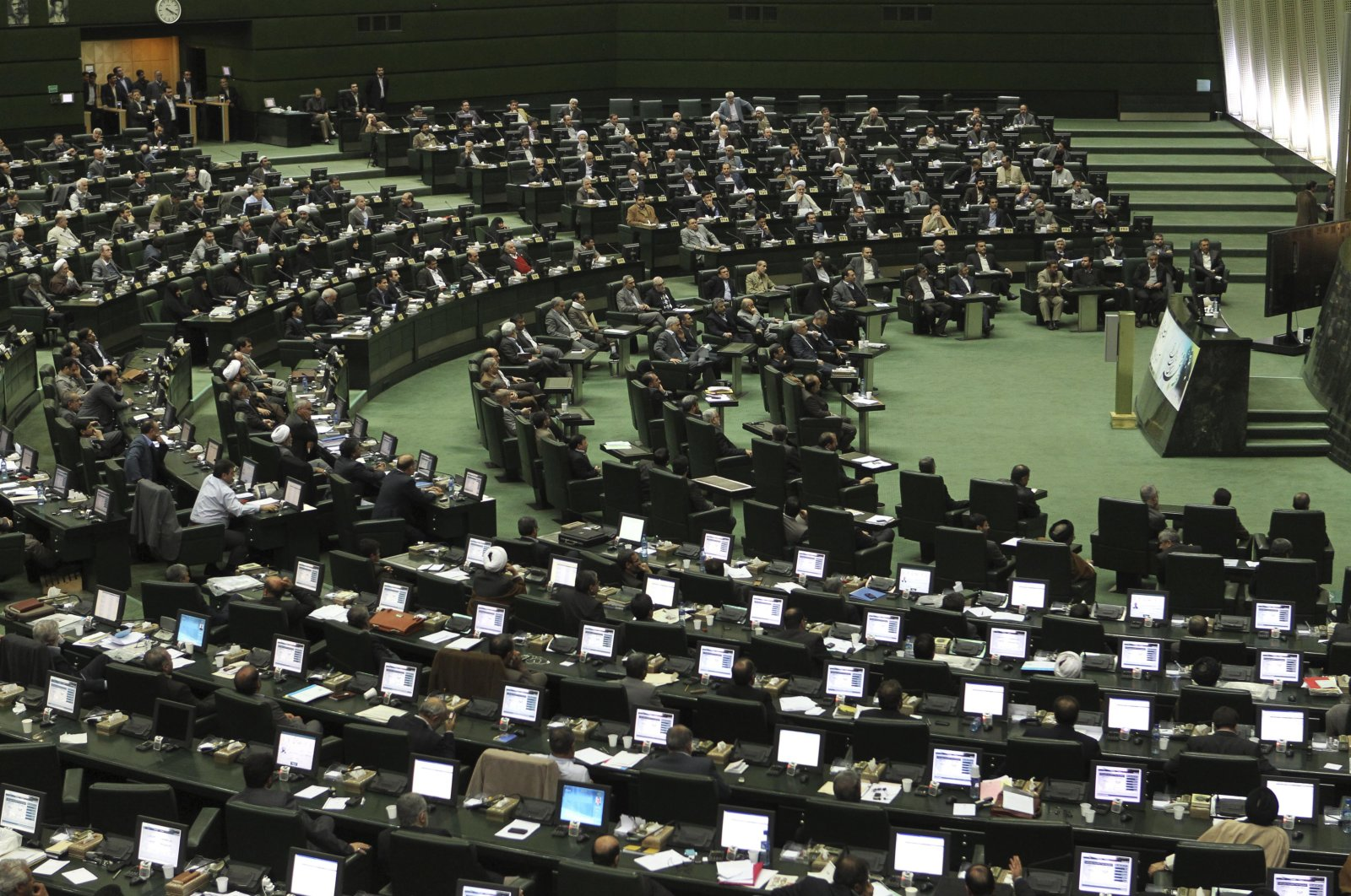 A view of Iran's parliament is seen during impeachment proceedings against the labor minister, Abdolreza Sheikholeslami, in Tehran, Iran, Sunday, Feb. 3, 2013. (AP Photo)