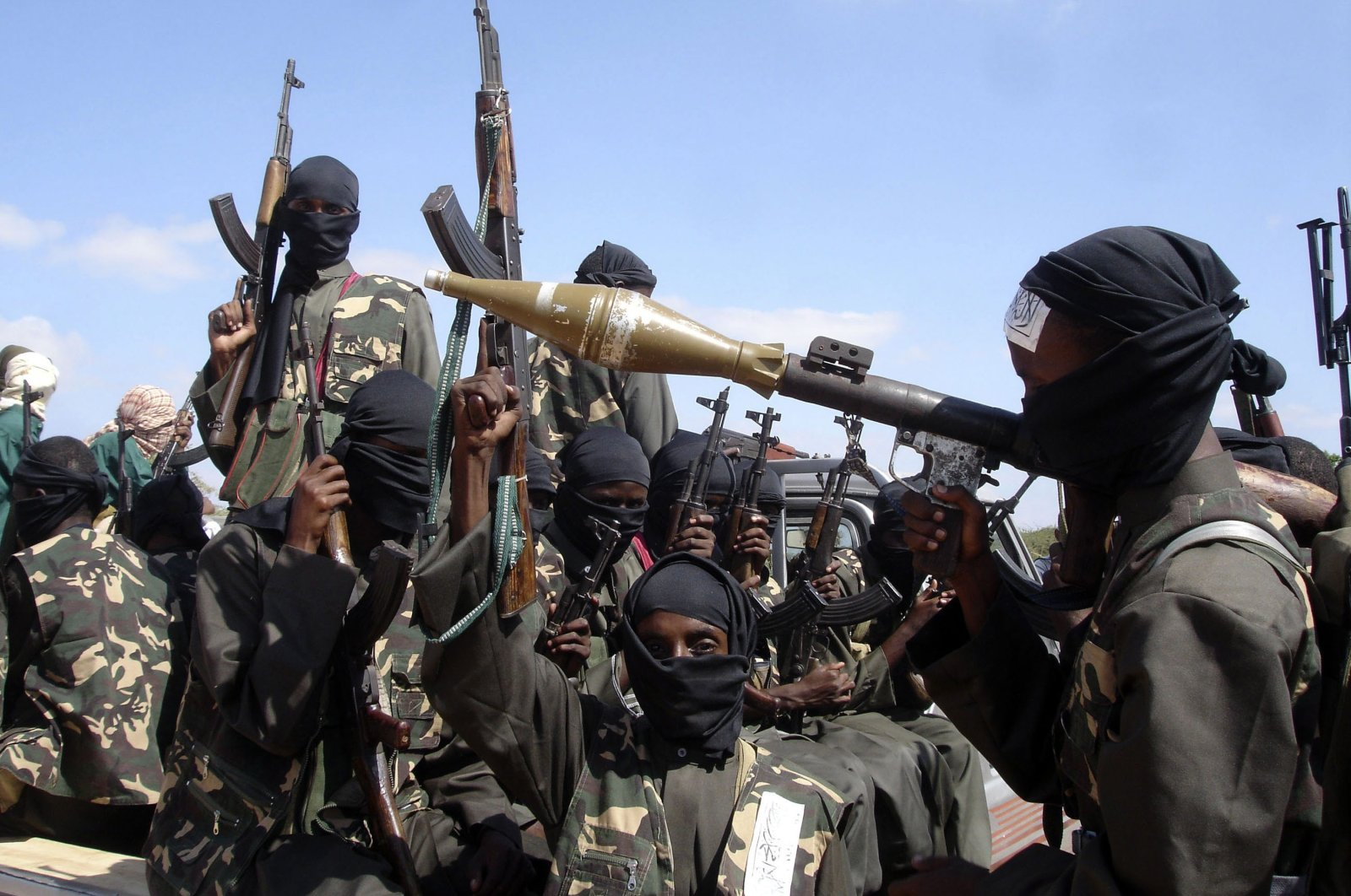 Armed Al-shabab militants on pickup trucks prepare to travel into the city, just outside Mogadishu, in Somalia, Dec. 8, 2008. (AP Photo)