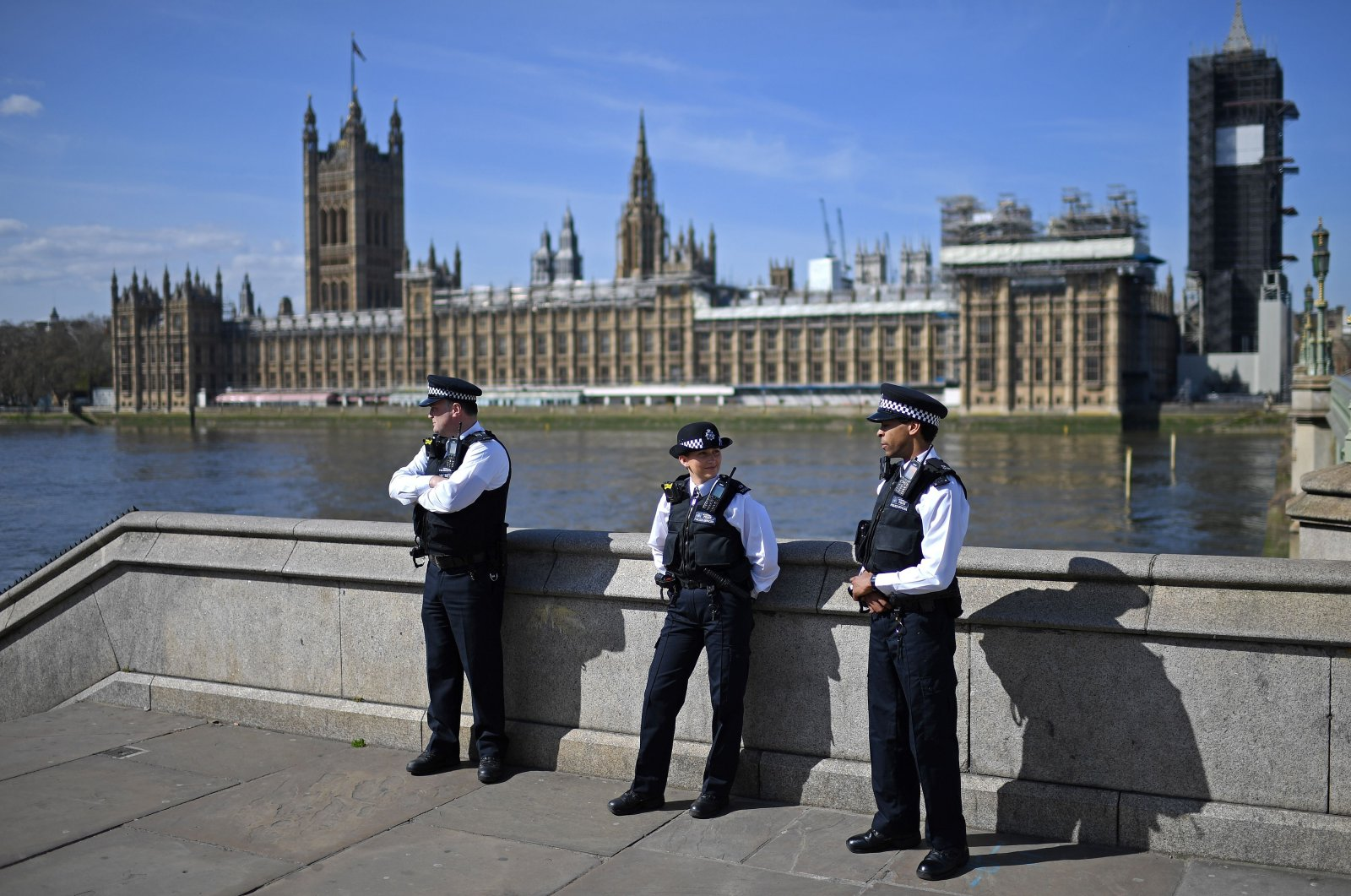 British police officers stand on duty outside St. Thomas' Hospital in central London, where Britain's Prime Minister Boris Johnson is in intensive care, Tuesday, April 7, 2020. (AFP Photo)