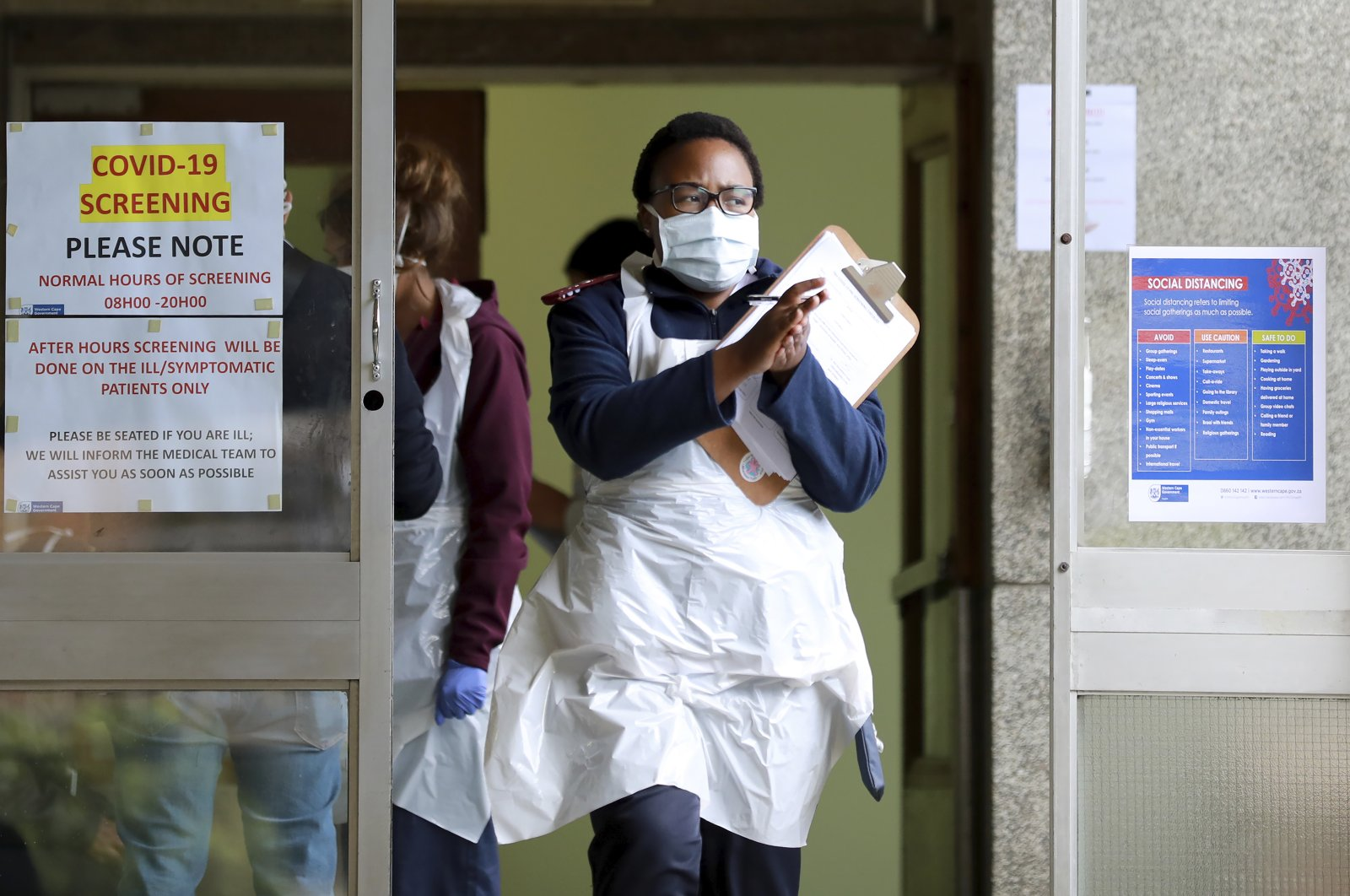 A medical worker sanitises her hands at a testing centre at Tygerberg Hospital in Cape Town, South Africa, Monday, April 6, 2020. (AP Photo)