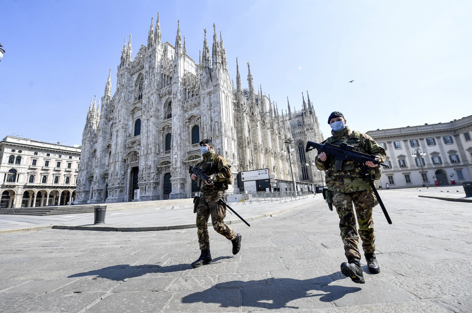 Soldiers patrol in front of the Duomo gothic cathedral in Milan, Italy, Sunday, April 5, 2020. (AP Photo)