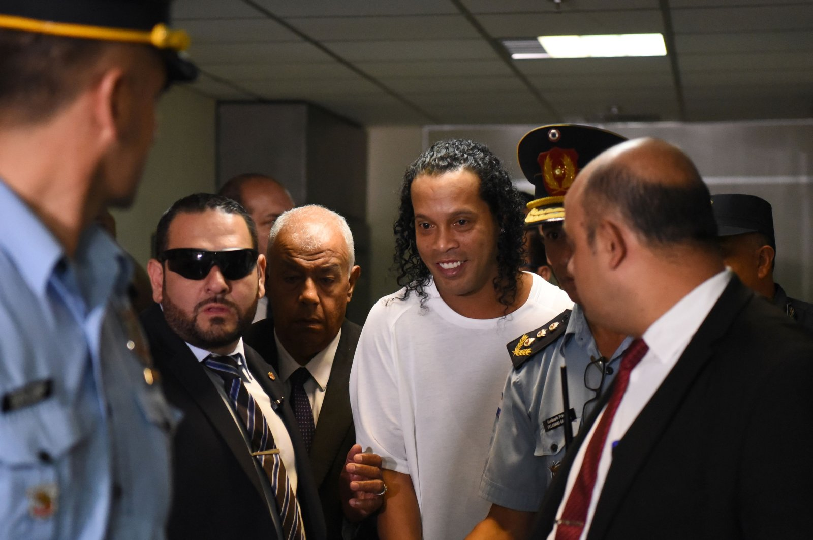Retired Brazilian football player Ronaldinho (C) arrives at Asuncion's Justice Palace to testify about his irregular entry into the country, in Asuncion, Paraguay, March 6, 2020. (AFP Photo)