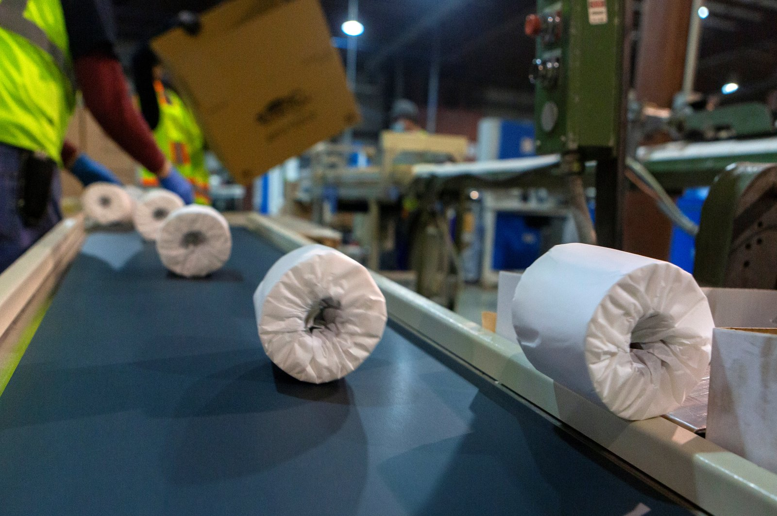 Individually wrapped rolls of toilet paper move down a line to be boxed at Tissue Plus in Bangor, Maine, U.S. April 7, 2020. (Reuters Photo)