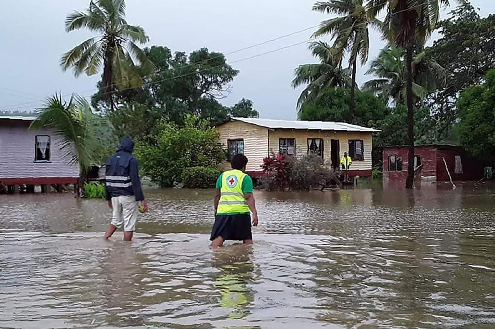 Rescue workers make their way through a village during flooding caused by Tropical Cyclone Harold in Nasolo in Fiji, Wednesday, April 8, 2020. (AFP Photo)