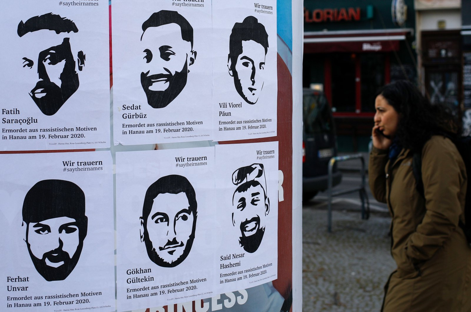 Posters with the pictures and names of victims of a far-right extremist gunman who killed nine people in a racist attack in Hanau, Germany on Feb. 19 can be seen on an advertising column in Berlin's Kreuzberg district, Germany, March 19, 2020. (AFP Photo)