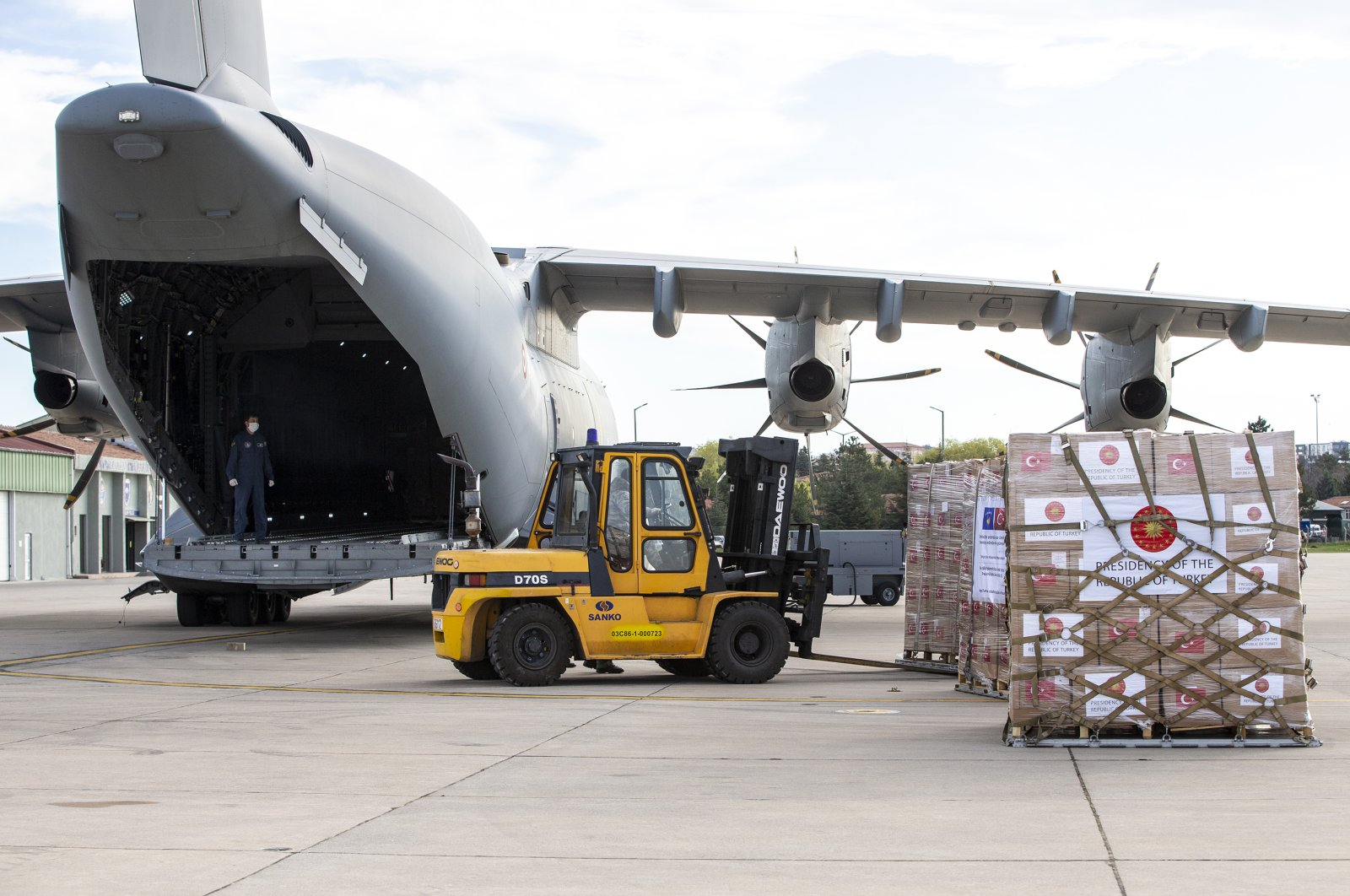 Medical aid is loaded onto a Turkish military cargo plane in Ankara, April 8, 2020. (AA Photo)