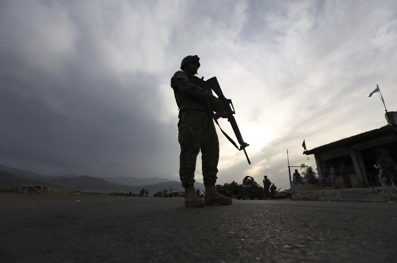 An Afghan National Army (ANA) soldier stands guard at a checkpoint on the Jalalabad-Kabul highway, east of Kabul, Afghanistan, Saturday, April 4, 2020. (AP Photo)