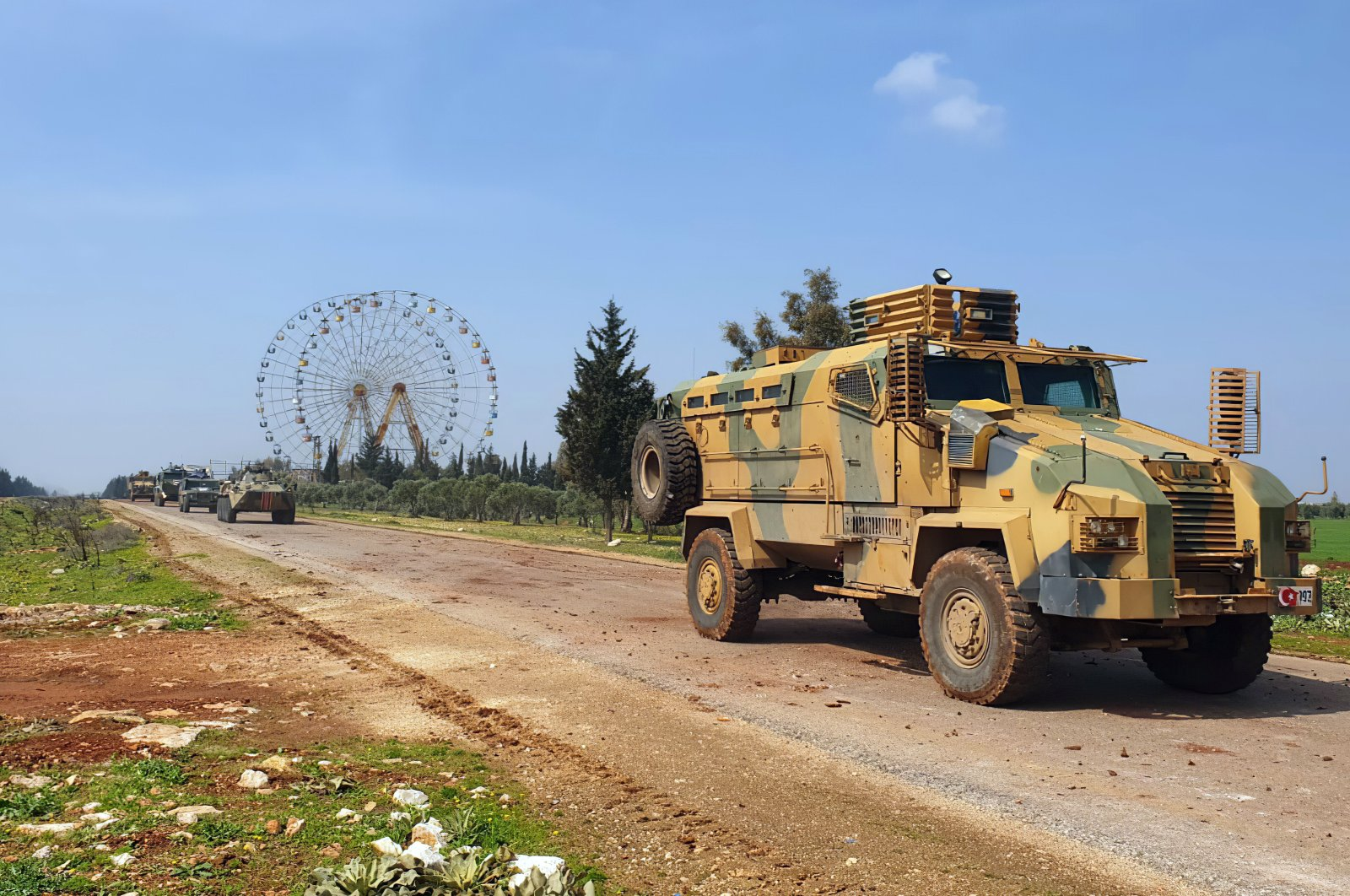 Turkish and Russian troops patrol on the M4 highway, which runs east-west through Idlib province, Syria, March 15, 2020. (Defense Ministry Photo)