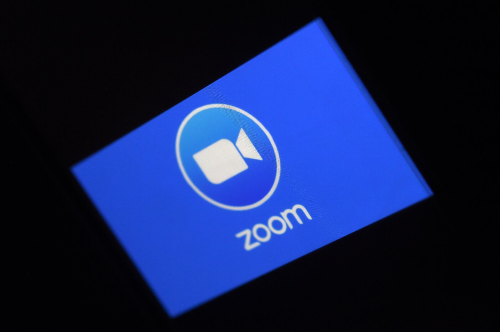In this file photo illustration taken Monday, March 30, 2020, a Zoom App logo is displayed on a smartphone in Arlington, Virginia, U.S. (AFP Photo)