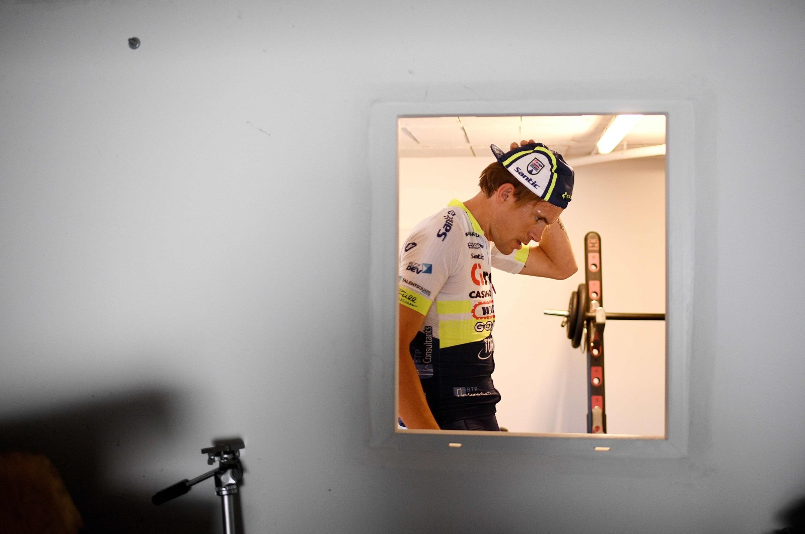 French professional cyclist Yoann Offredo trains in the garage of his house during the outbreak, Montherly, Friday, April 3, 2020. (AFP Photo)