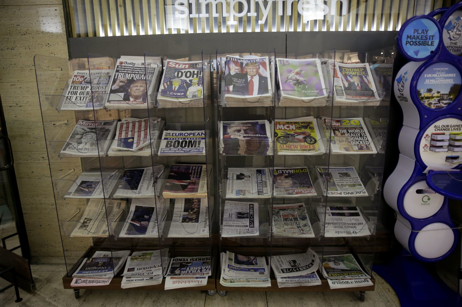 Newspapers are displayed for sale outside a store in London, Thursday, Nov. 10, 2016. (AP Photo)