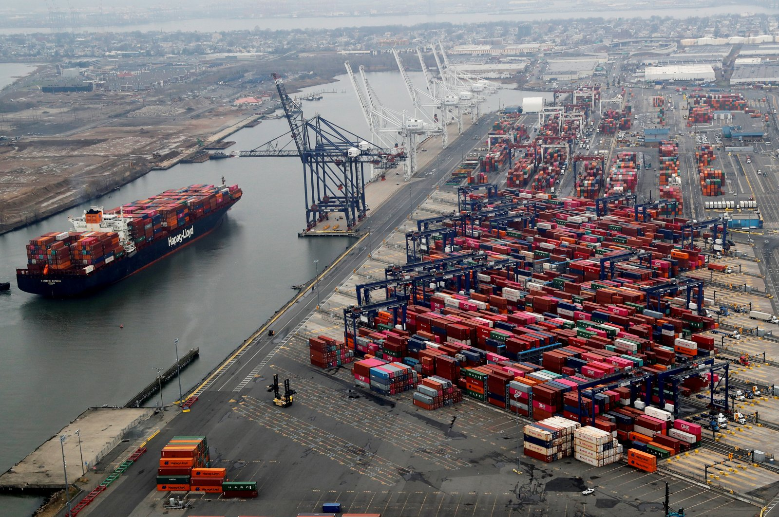 Hundreds of shipping containers are seen stacked at a pier at the Port of New York and New Jersey in Elizabeth, New Jersey, U.S., March 30, 2020. (Reuters Photo)