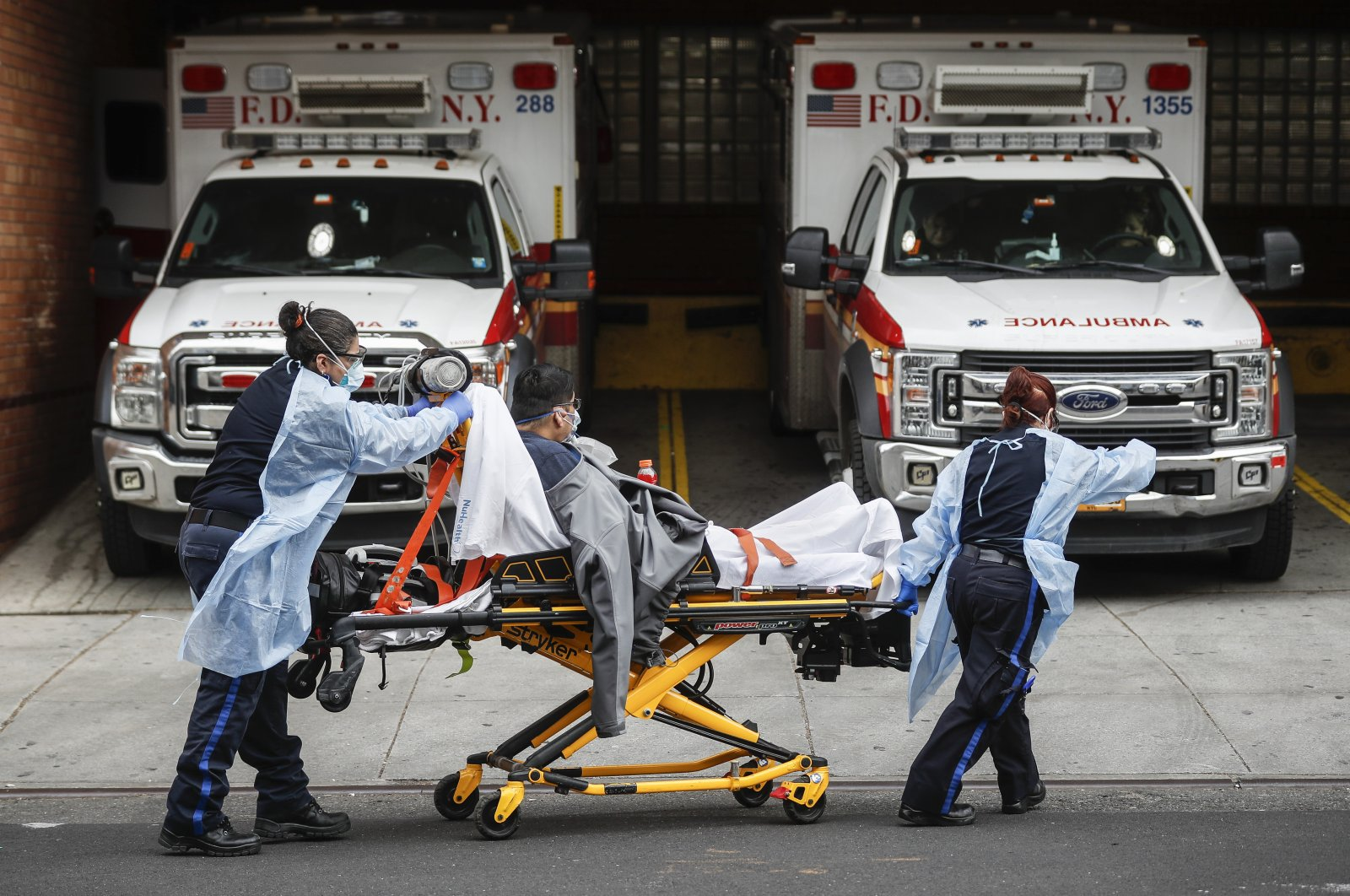 Patients are brought into Wyckoff Heights Medical Center by staff wearing personal protective gear due to COVID-19 concerns, Tuesday, April 7, 2020, in the Brooklyn borough of New York. (AP Photo)