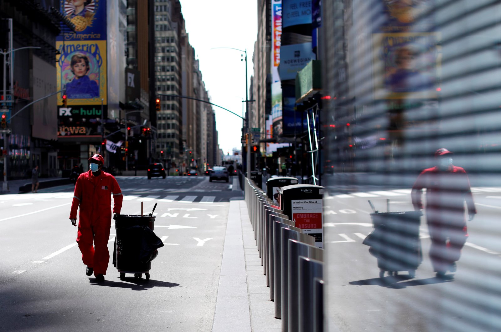 A Times Square Alliance street sweeper walks through a nearly empty Times Square in Manhattan during the outbreak of the coronavirus in New York City, New York, U.S., Tuesday, April 7, 2020. (Reuters Photo)