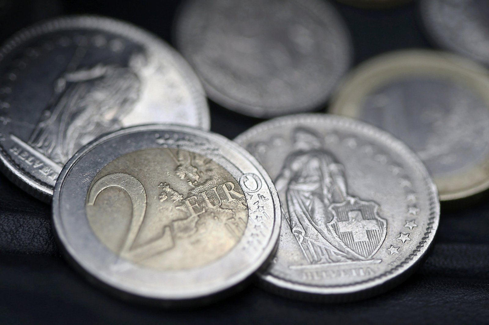 Euro and Swiss franc coins are seen in this photo in Bern, Switzerland, Jan. 16, 2015. (Reuters Photo)