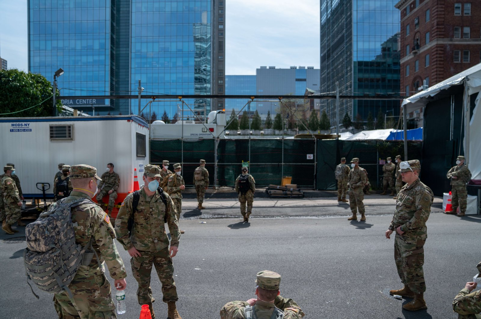A group of soldiers on a side street behind the medical examiners office, New York, April 7, 2020. (AFP Photo)