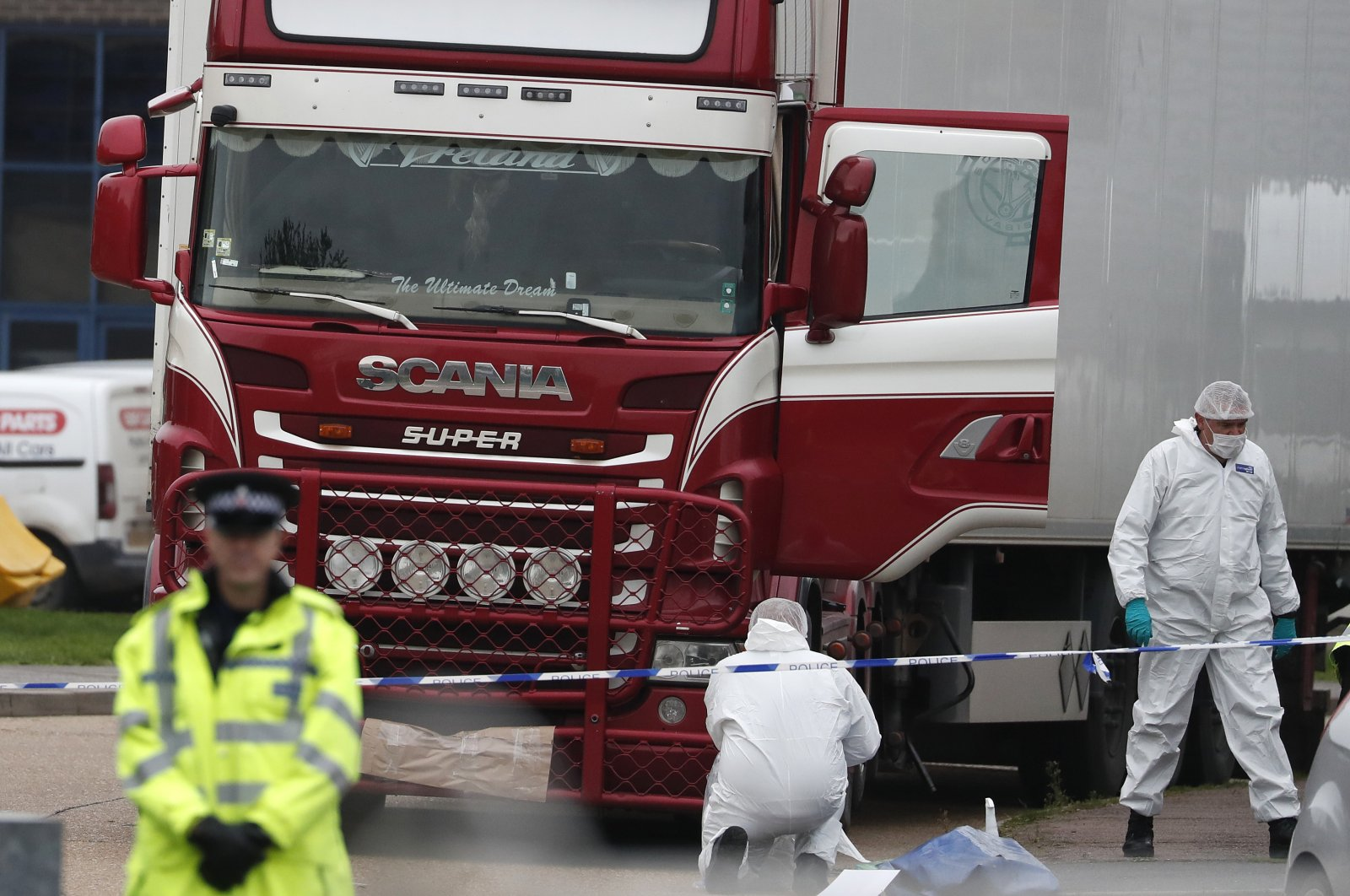 Forensic police officers attend the crime scene where the 39 dead bodies were found in a truck, in Grays, South England, Oct. 23, 2019. (AP Photo)