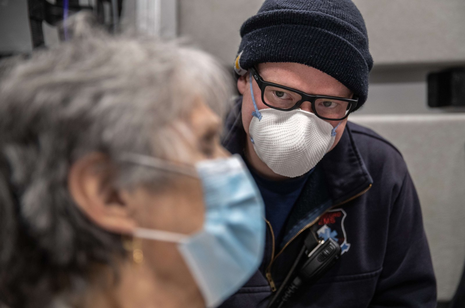 A paramedic watches over Janet Gazo, 89, while transporting her by ambulance to Stamford Hospital, Connecticut, Friday, April 3, 2020  (AFP Photo)