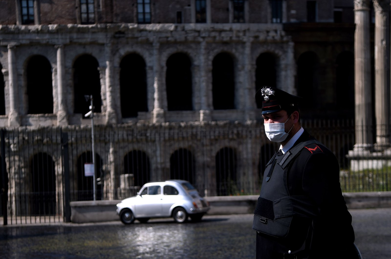 An Italian Carabiniere patrols by the Teatro di Marcello, Rome, April 8, 2020. (AFP Photo)