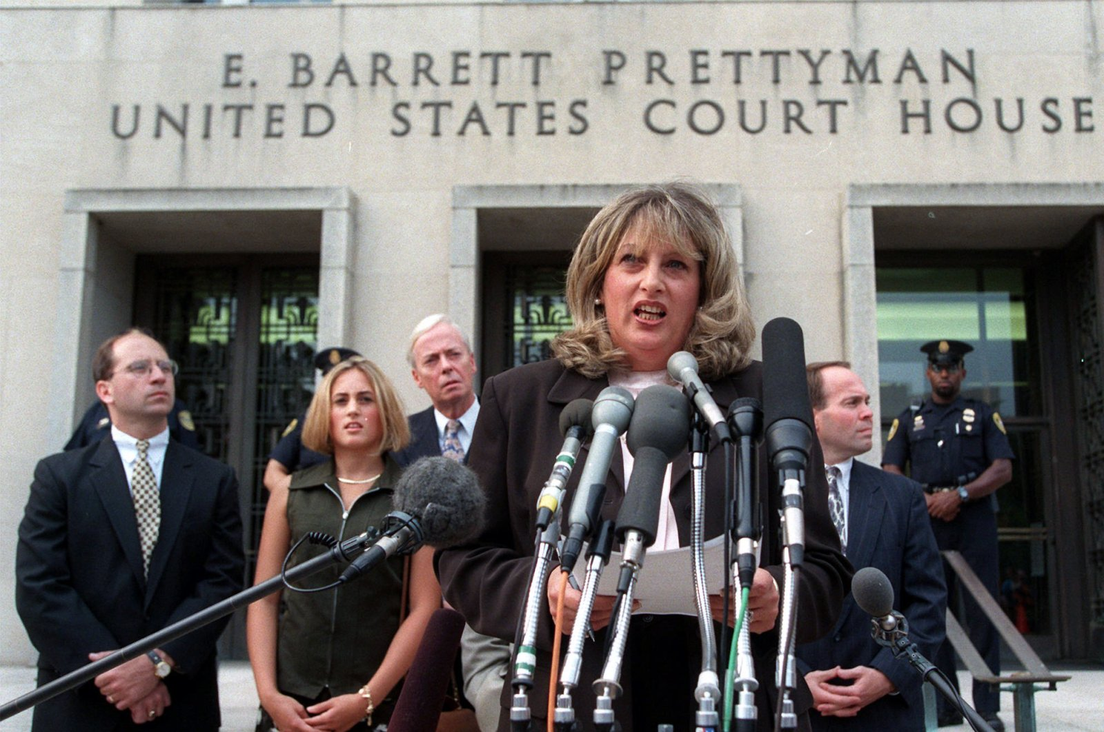 In this July 29, 1998, file photo Linda Tripp meets with reporters outside federal court in Washington after her final appearance before a grand jury investigating an alleged affair between President Bill Clinton and Monica Lewinsky. (AP Photo)