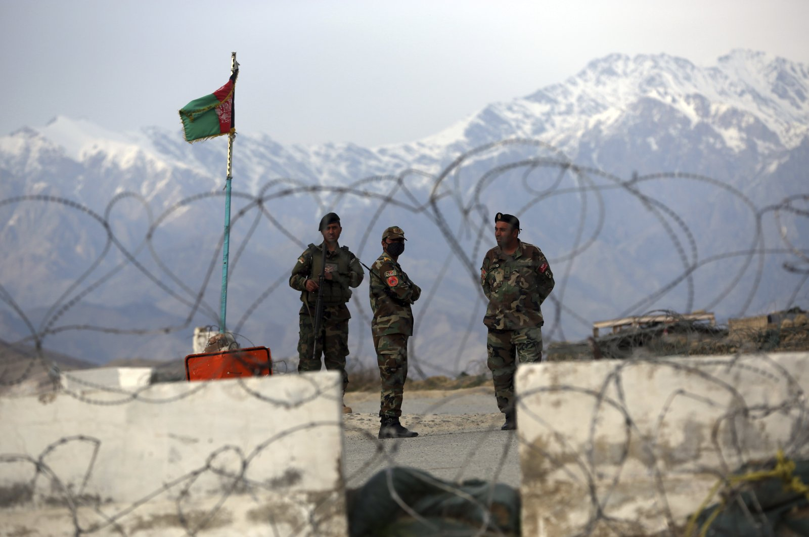 Afghan National Army soldiers stand guard at a checkpoint near the Bagram base in northern Kabul, Afghanistan, April 8, 2020. (AP Photo)