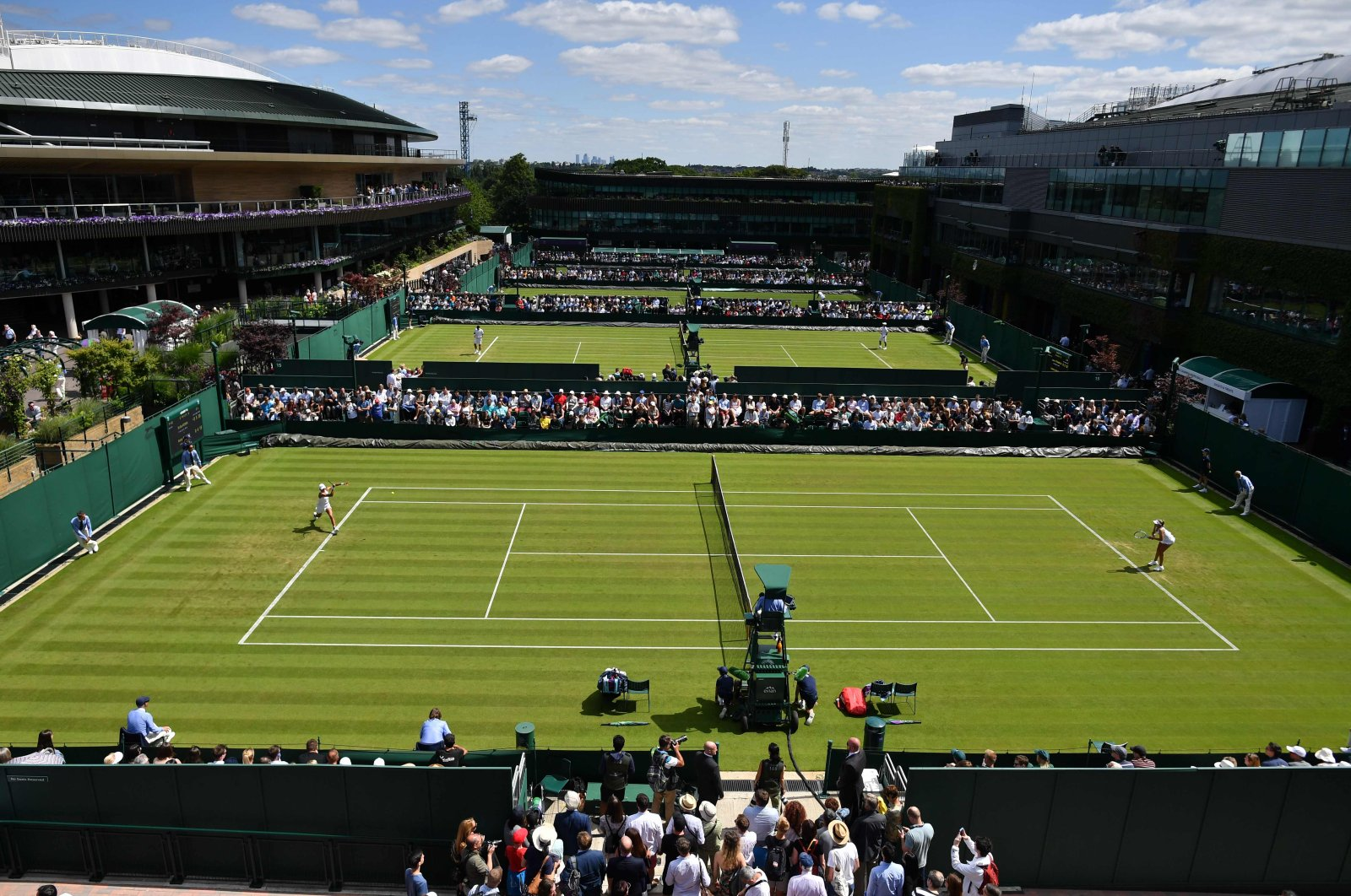 A tennis match is held on the outer courts at the All England Tennis Club in Wimbledon, southwest London, July 1, 2019. (AFP Photo)