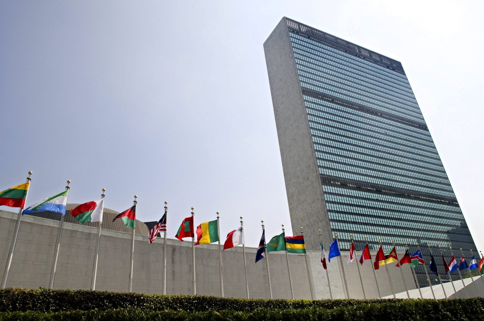 The flags of member nations fly outside the General Assembly building at the United Nations headquarters in New York, Sept. 13, 2005 (AP Photo)