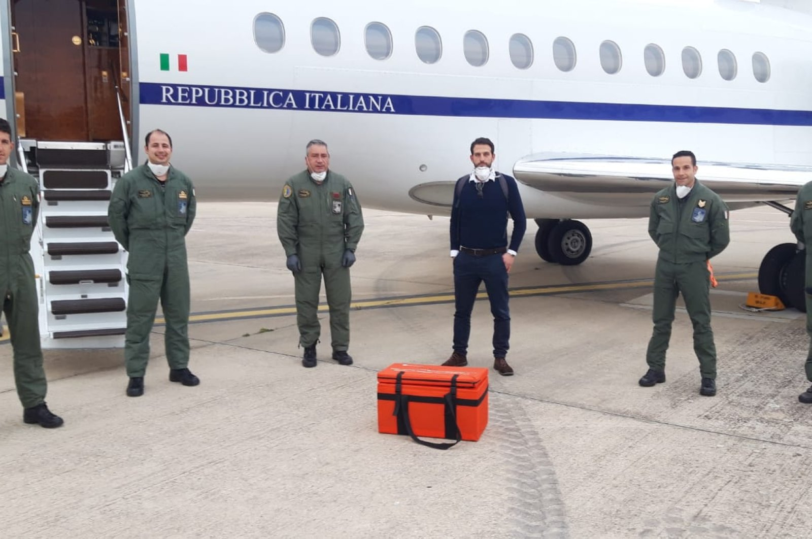 The Italian team poses with the container carrying the stem cells before departing from Atatürk Airport, Istanbul, Turkey, March 31, 2020. (AA Photo)