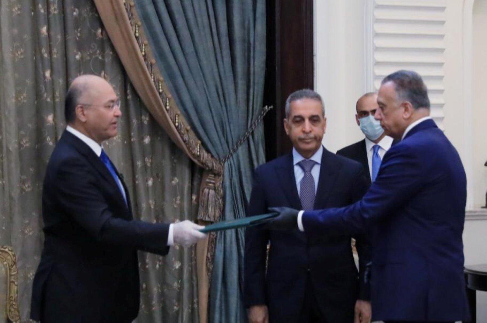 Iraq's President Barham Salih instructs newly appointed Prime Minister Mustafa al-Kadhimi, Baghdad, April 9, 2020. (REUTERS Photo)