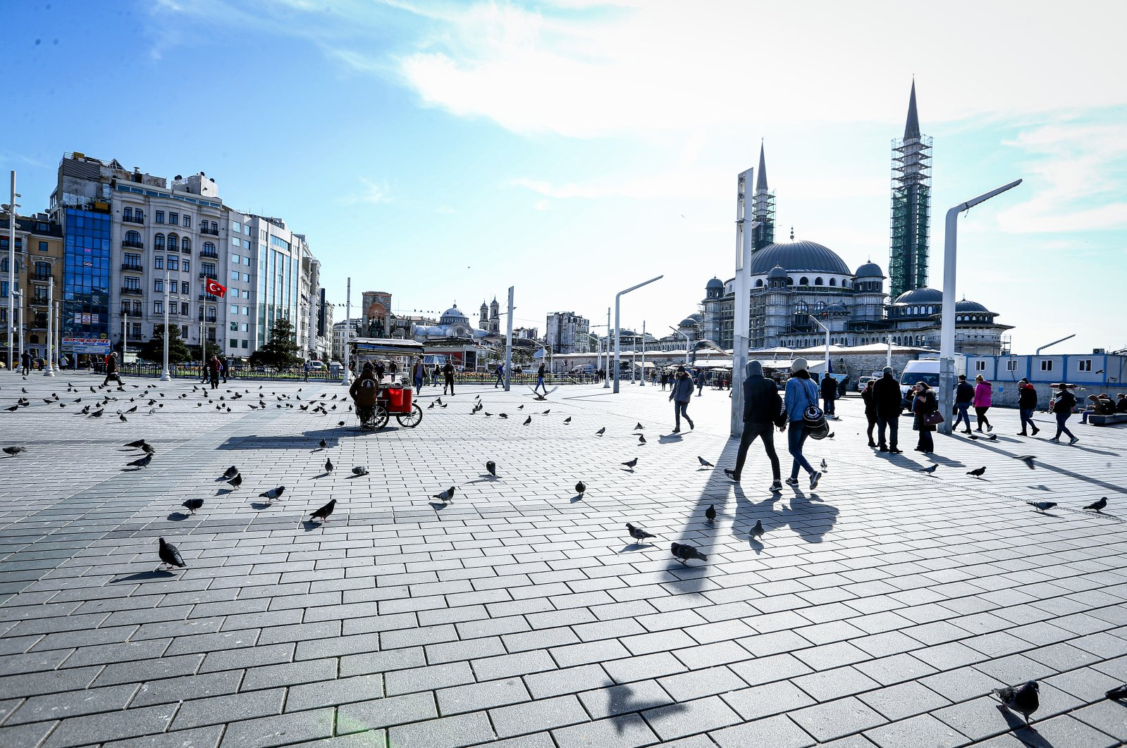 People are seen walking at Taksim Square in Istanbul, Turkey, March 17, 2020. (AA Photo)
