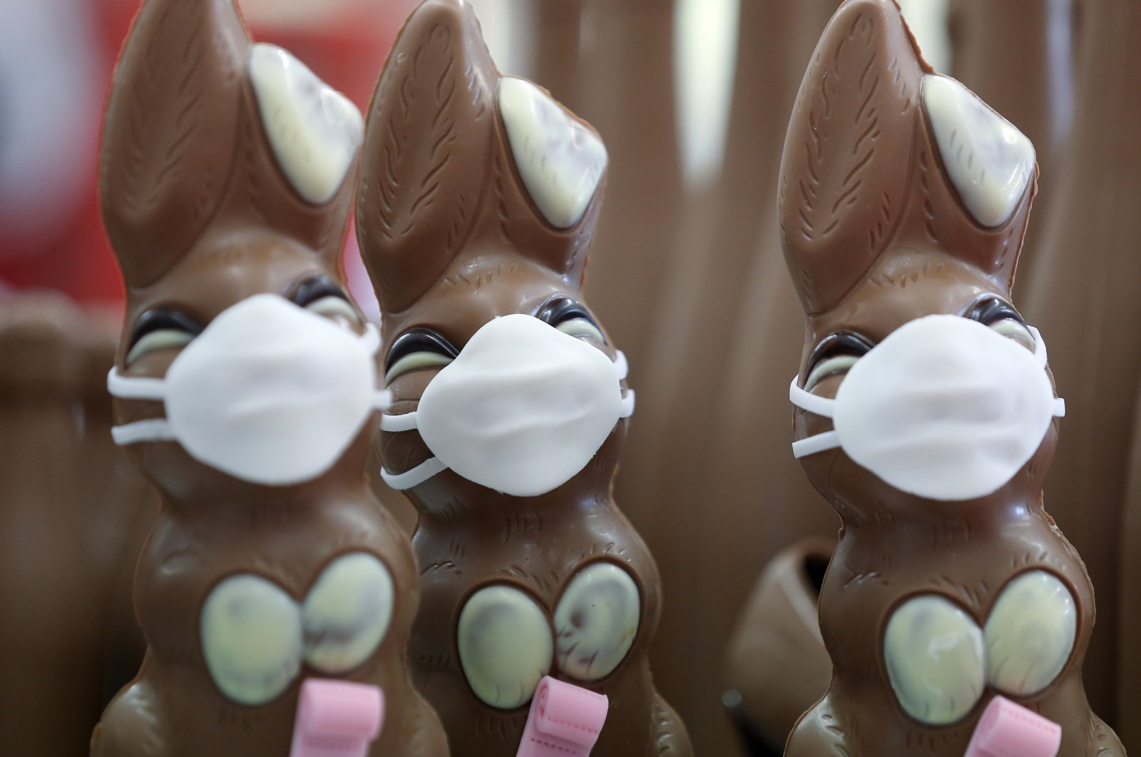 Chocolate Easter bunnies wearing protective masks and holding rolls of toilet paper are seen at a chocolate factory in Pirmasens, Germany, April 9, 2020. (Reuters Photo)