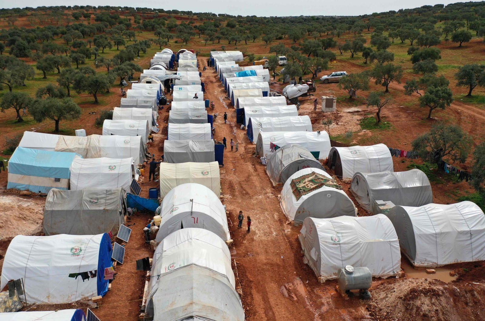 An aerial view of a camp for displaced Syrians from Idlib and Aleppo provinces, near the town of Maaret Misrin in Syria's northwestern Idlib province, Sunday, April 5, 2020. (AFP Photo)