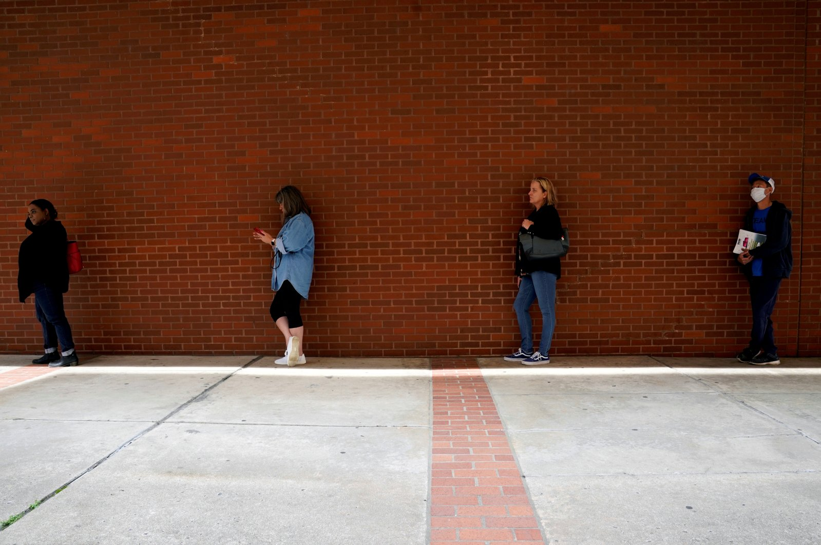 People who lost their jobs wait in line to file for unemployment benefits, following an outbreak of COVID-19, at Arkansas Workforce Center in Fort Smith, Arkansas, U.S., April 6, 2020. (Reuters Photo)