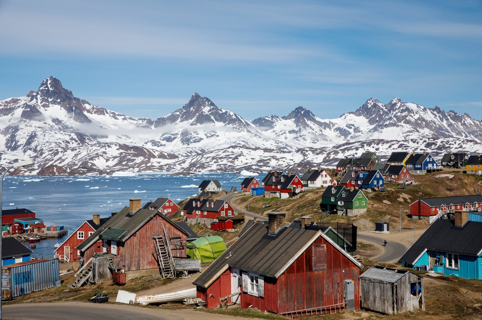 Snow covered mountains rise above the harbor and town of Tasiilaq, Greenland, June 15, 2018. (Reuters Photo)