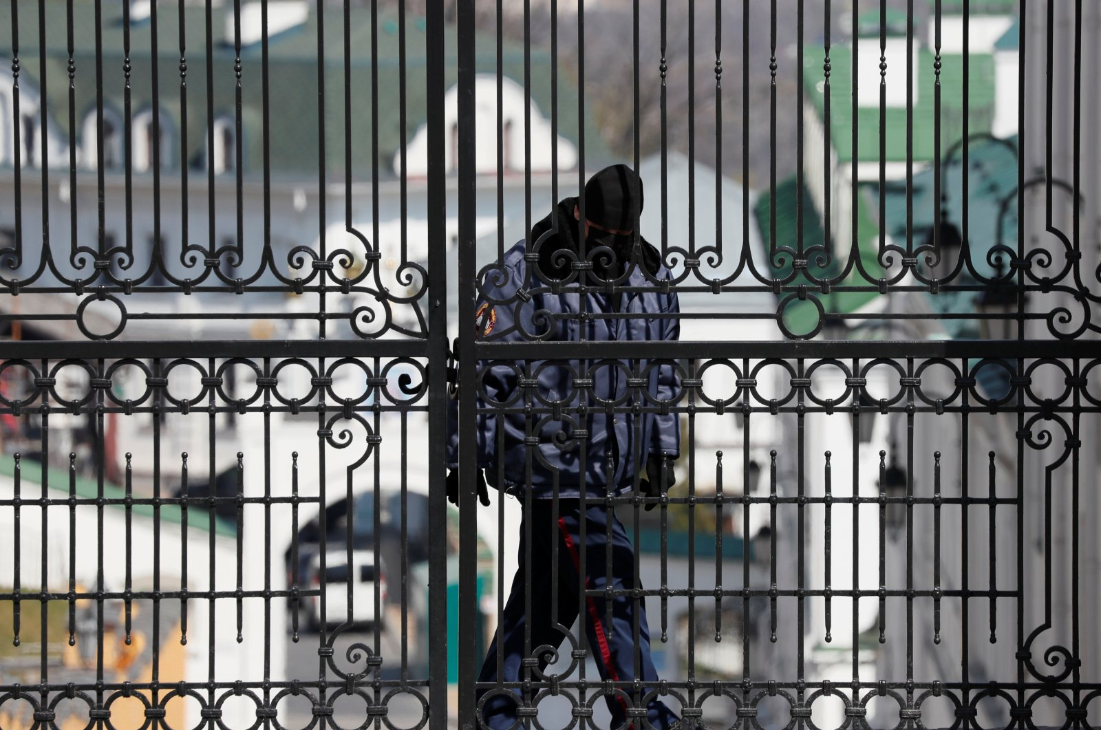 A security guard wearing a protective face mask is seen at the gate of Kyiv Pechersk Lavra monastery during the COVID-19 outbreak in Kyiv, Ukraine, Thursday, April 9, 2020. (Reuters Photo)