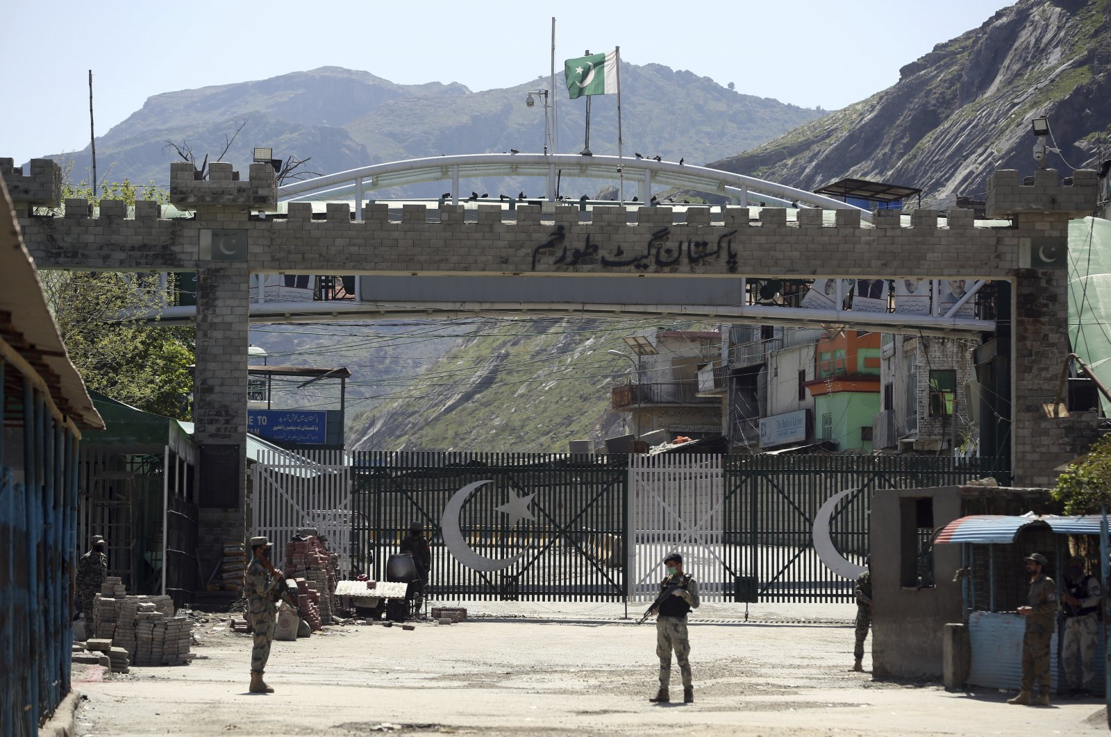 Afghan border police stand guard at the Torkham border crossing between Afghanistan and Pakistan, Saturday, April 4, 2020. (AP)