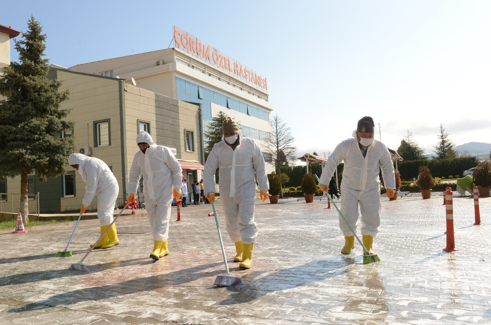 Municipality workers clean the streets in Çorum, Turkey, Thursday, April 9, 2020. (AA Photo)