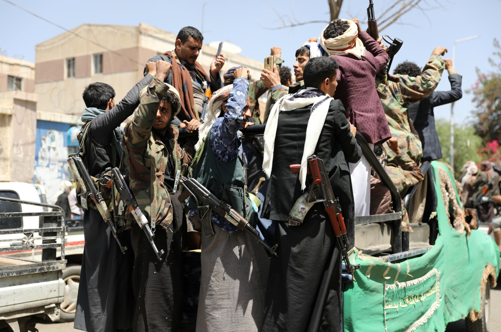 Armed Houthi rebels ride on the back of a truck outside a hospital in Sanaa, Yemen, Wednesday, April 8, 2020. (REUTERS Photo)